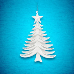 Christmas tree on a background of blue paper