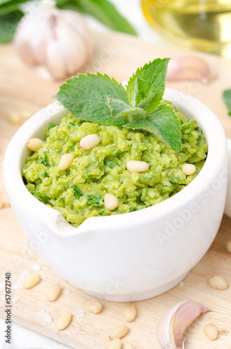 pesto with green peas, mint and pine nuts, vertical close-up