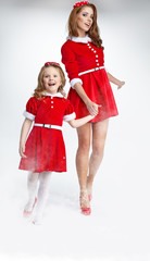 Two sister dressed in santa claus costume