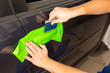 Car wrapping specialist wraps car door handle with adhesive film