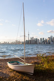 Sailing boat on Toronto Islands with city