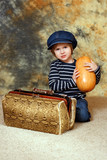 The boy with suitcase and pumpkin