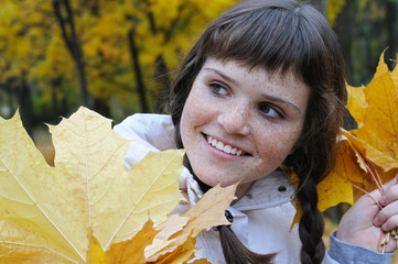 close-up portrait of freckled teenage girl