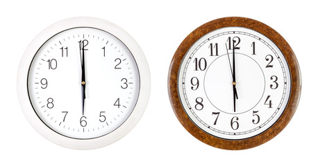 Two clock faces showing six o'clock