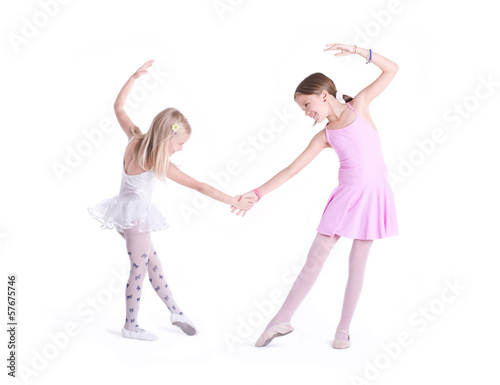 Two cute Ballerinas holding hands.