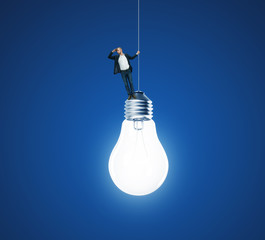 Businessman and huge light bulb