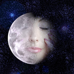 moon turns into face of the beautiful woman in night sky.