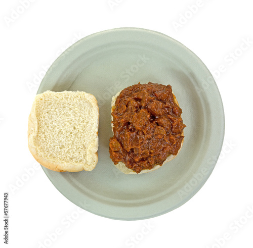 Chipped pork in barbecue sauce sandwich on a paper plate