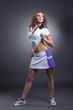 Slender feminine athlete posing in sportswear
