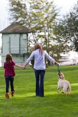 Mom And daughter walking the dog
