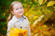 Little girl outdoors at autumn day
