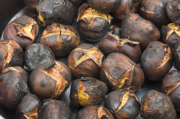 Delicious roasted chestnuts group in a pot