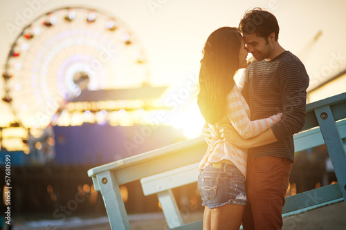 Fotobehang Amusementspark romantic couple kissing at sunset