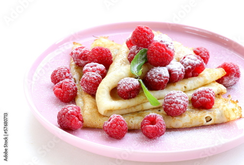 pancakes (crepes) with raspberries and mint -  healthy breakfast