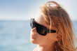 Little blond girl portrait with sunglasses
