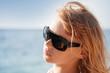 Little blond girl portrait with sunglasses