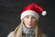 attractive blonde female santa, christmas season, studio shoot