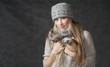 Portrait of woman on dark background wearing woolen accessories