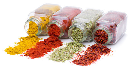 Spice pouring out of set of spice jars