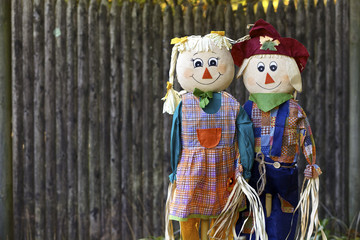 Two scarecrows in garden