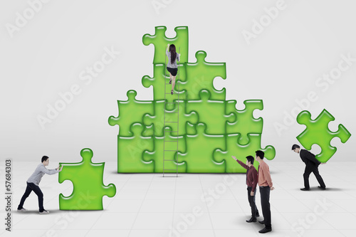 Business team work building a puzzle