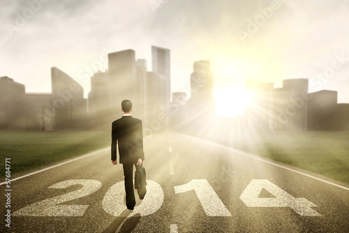 Businessman walking to the New Year 2014