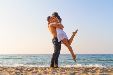 Young couple love play at the beach