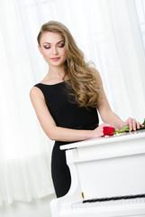 Half-length portrait of woman in black dress