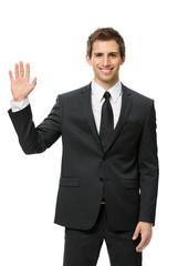 Half-length portrait of waving hand businessman