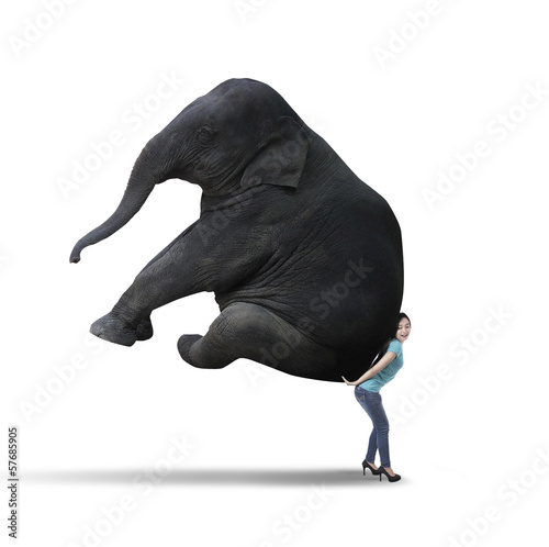 Woman carrying big elephant - isolated