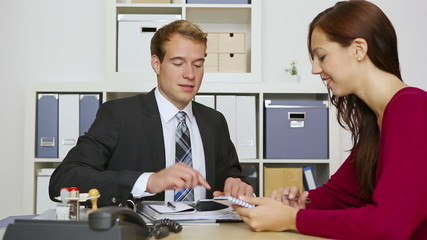 Businessman talking to client in meeting