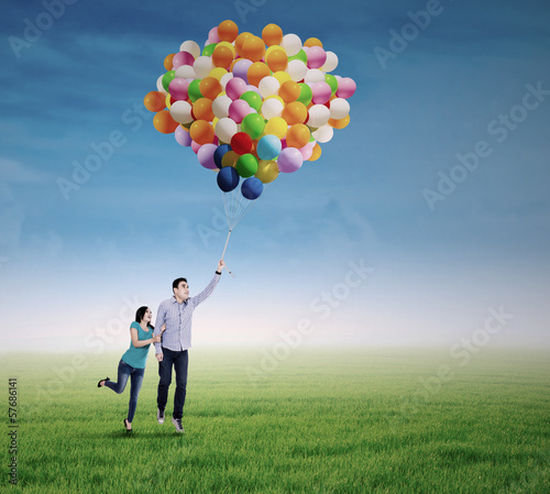 Young couple with colorful balloons