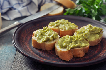 canapes of bread and guacamole