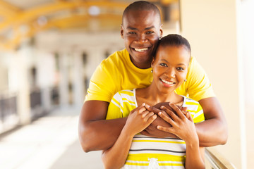 young african american couple hugging