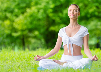 Woman with closed eyes sits in asana position zen gesturing
