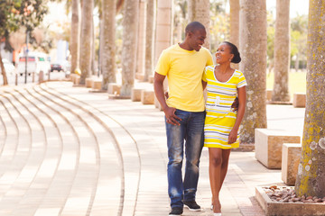 young afro american couple walking on urban street