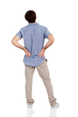 young man having back pain isolated on white
