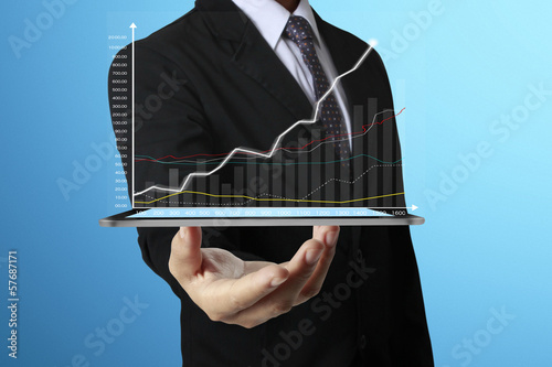 hand touch screen graph on  tablet