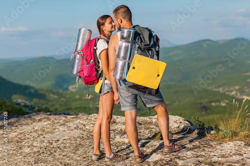 Two backpackers in mountains.