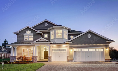 Beautiful Home Exterior at Night - 57688178