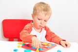 little boy learning shapes, early education