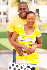 lovely afro american couple with shopping bag