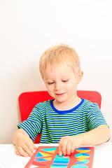 little boy learning shapes, early education