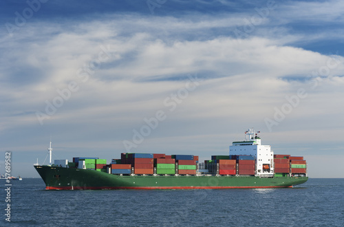 Container cargo ship sailing on the ocean