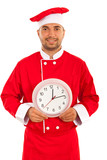 Cheerful chef with clock