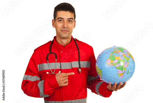 Paramedic pointing to earth globe