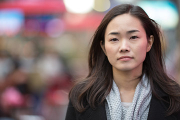 Asian woman in New York City sad face