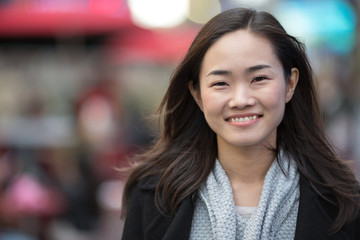 Asian woman in New York City smile happy face