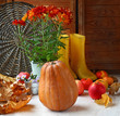 Autumn still life with pumpkin, apple and  yellow gumboots