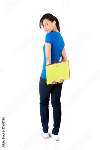 Beaufitul woman standing with a book.